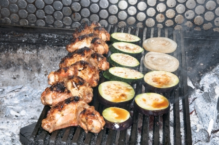 cooking chicken wings grilled vegetables photo