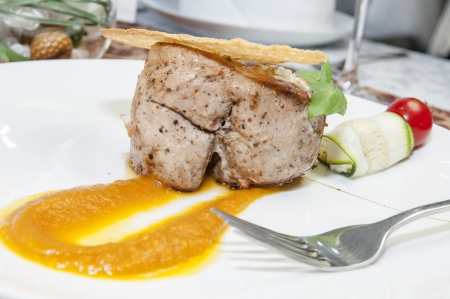 baked meat with sauce on a table in a restaurant Stock Photo - 15578851