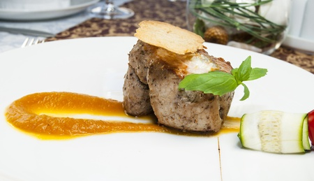 baked meat with sauce on a table in a restaurant Stock Photo - 15578758