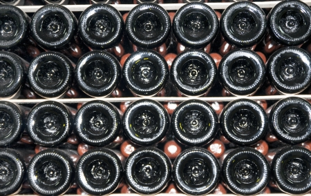 mustiness: wine bottles stored in the old wine cellar Stock Photo