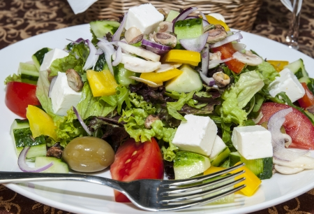 Greek salad on a table in a restaurant Stock Photo
