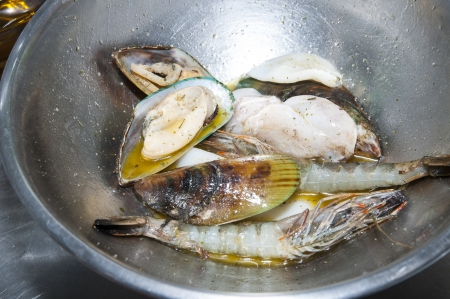 seafood cooking in sunflower oil in a frying pan photo