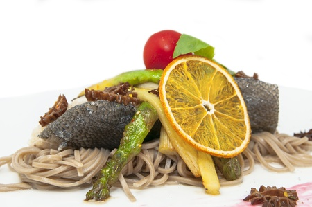 baked fish with spaghetti and mushrooms and vegetables Stock Photo - 15966642