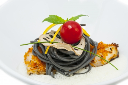 baked fish with black and white spaghetti sauce Stock Photo - 15966712