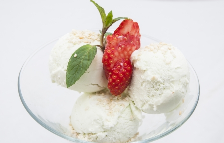 fruit with ice cream on a white dish at restaurant photo