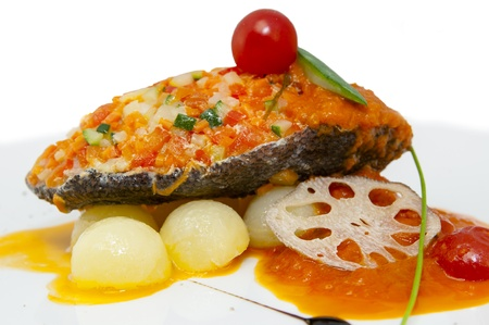 baked fish with potatoes in tomato sauce photo