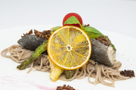 baked fish with spaghetti and mushrooms and vegetables Stock Photo - 16319420