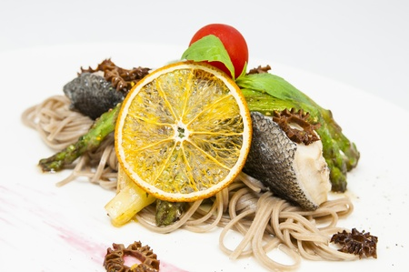baked fish with spaghetti and mushrooms and vegetables Stock Photo - 16319424