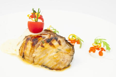 Roasted fillet of grilled fish in a white sauce Stock Photo - 16342700
