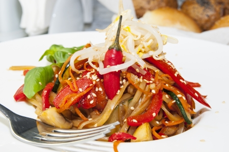 Rice spaghetti with vegetables on a white plate in a restaurant Stock Photo - 16344179