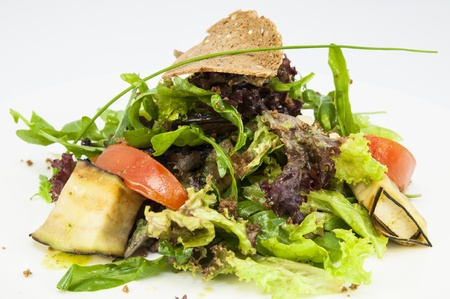 salad with cheese and herbs and vegetables photo