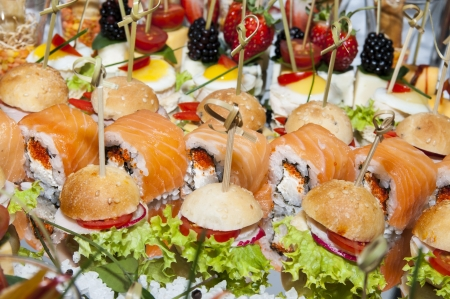 canape with meat seafood egg and cheese photo