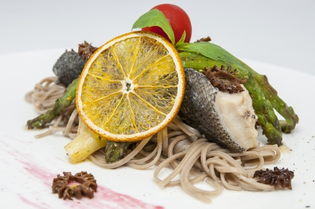 baked fish with spaghetti and mushrooms and vegetables Stock Photo - 16345101