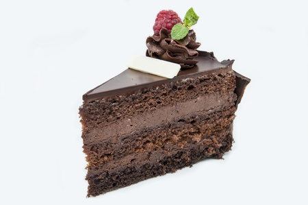 piece of chocolate cream cake on a white background in the restaurant photo