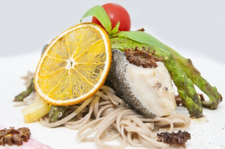 baked fish with spaghetti and mushrooms and vegetables Stock Photo - 16800307