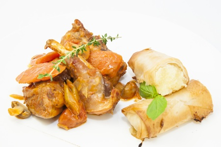 rabbit stew with mushroom sauce and cheese rolls photo