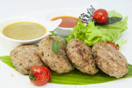 vegetarian meatballs with salad on a white background in restaurant Stock Photo