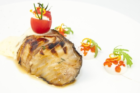 Roasted fillet of grilled fish in a white sauce Stock Photo - 16851682