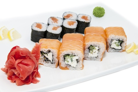 Japanese rolls in a restaurant with fish and vegetables photo