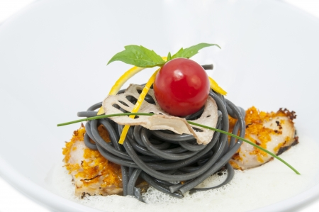 baked fish with black and white spaghetti sauce Stock Photo - 16981039
