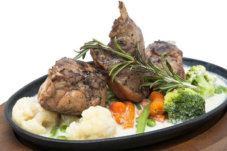 roasted rabbit meat and potatoes with vegetables photo