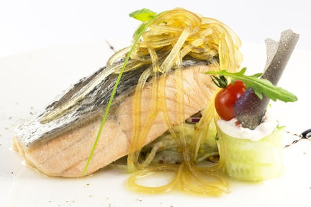 baked salmon with vegetables on a white background in the restaurant photo