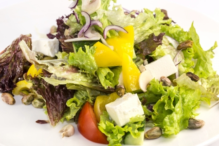 Greek salad on a white background in the restaurant Stock Photo - 17097190