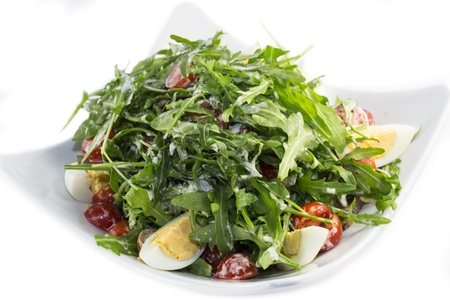 salad greens and egg sauce in a restaurant Stock Photo