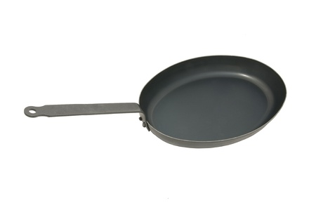 pan for cooking the steak on a white background Stock Photo - 17164996