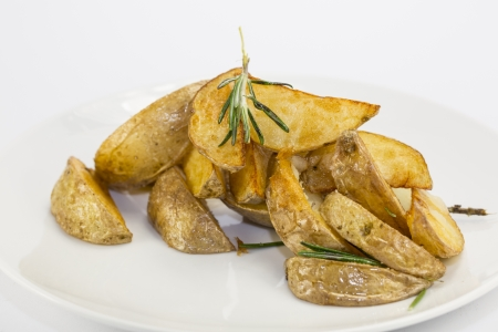 fried potatoes on a white background in the restaurant Stock Photo - 17210791