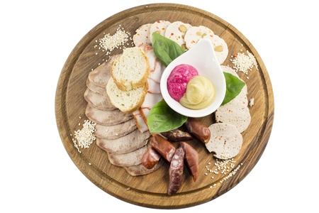 wooden plate with several kinds of sausages and bacon Stock Photo - 17282001
