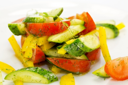 salad of fresh vegetables on a white plate photo
