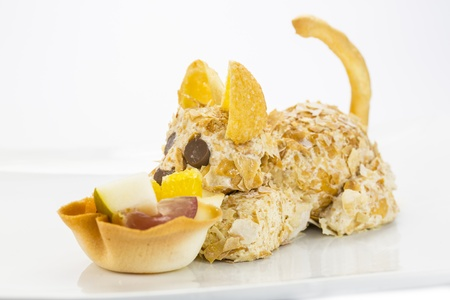 ice cream in the shape of a cat with a basket of fruit Stock Photo - 17441094