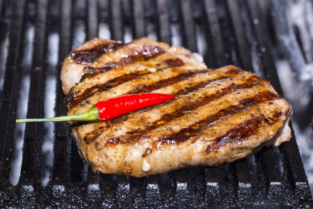 cooking steak and vegetables on the grill photo