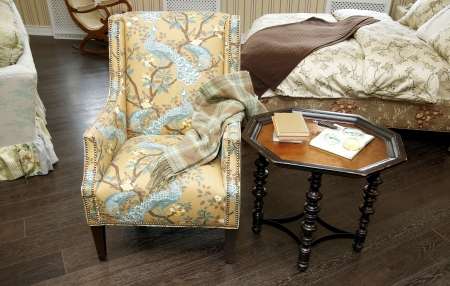 comfortable upholstered chairs and a coffee table with books