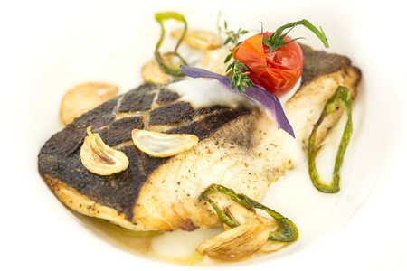 baked fish in cream sauce with lemon photo