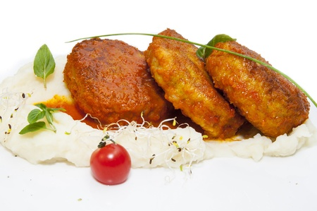 cutlets fried in carrot sauce with mashed potatoes photo