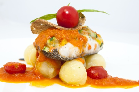 baked fish with potatoes in tomato sauce