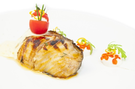 Roasted fillet of grilled fish in a white sauce Stock Photo - 17804179
