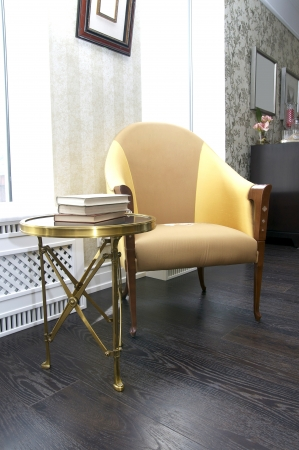 chair and a small table for books