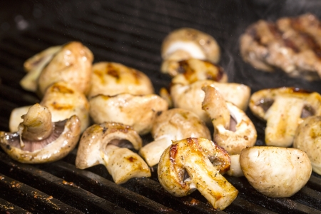 detoxing: Cooking mushrooms on the grill in the restaurant Stock Photo