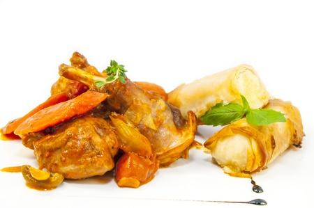 rabbit stew with mushroom sauce and cheese rolls Stock Photo - 19306375