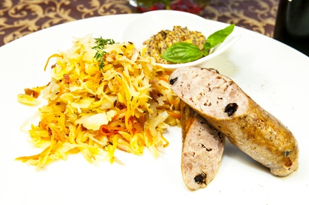 sausages with sauerkraut and mustard on a white background photo