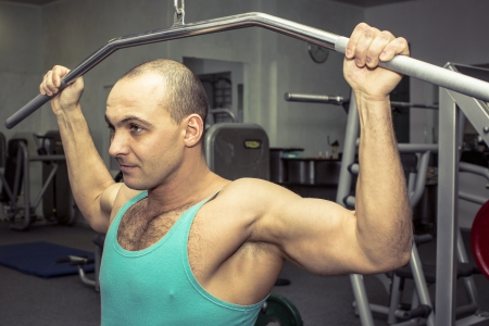 Young man training in the gym photo
