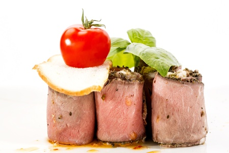 meat rolls with cheese decorated with tomato