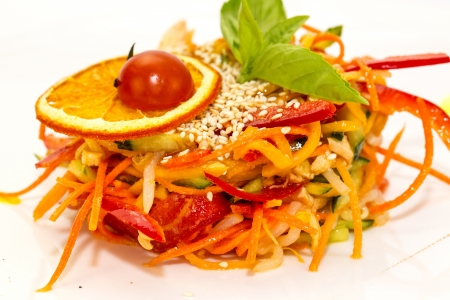 salad of steamed vegetables on a white plate in a restaurant photo
