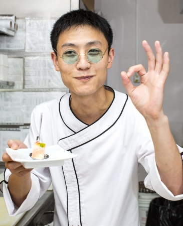 Japanese chef with a plate of sushi photo