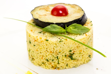 couscous embellished with eggplant and tomato photo