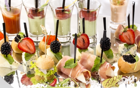 canape with meat vegetables and seafood photo