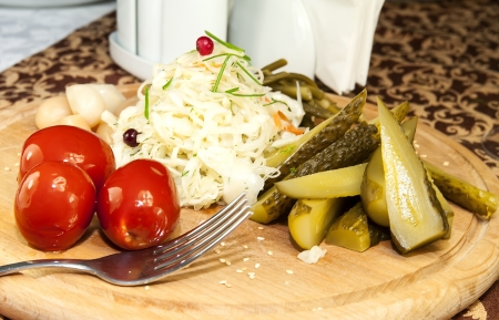 pickled vegetables, cucumber tomatoes asparagus and garlic cabbage photo